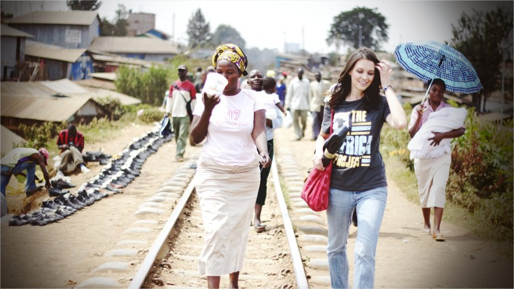 Joelle and Monica walking on the train tracks in the Kibera slums