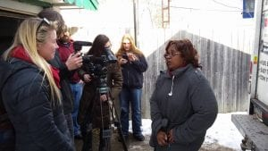 Elise Conklin films as producer Liv Larsen interviews Charlotte Hutchins during a water run to her women's home in Flint.