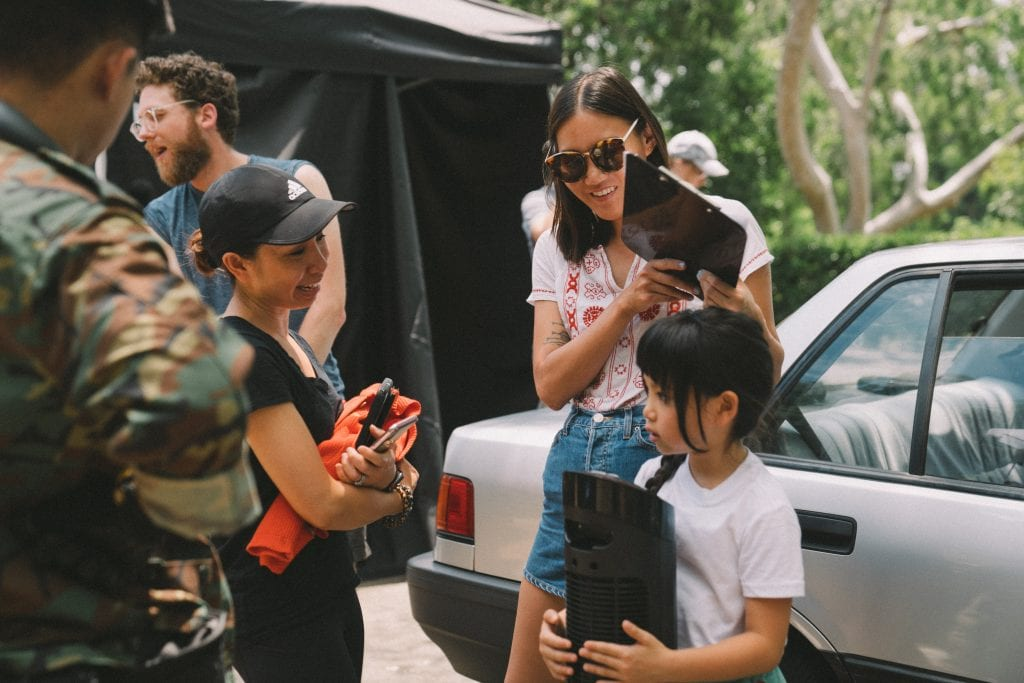 Two film crew members chatting with the actors from Hello From Taiwan