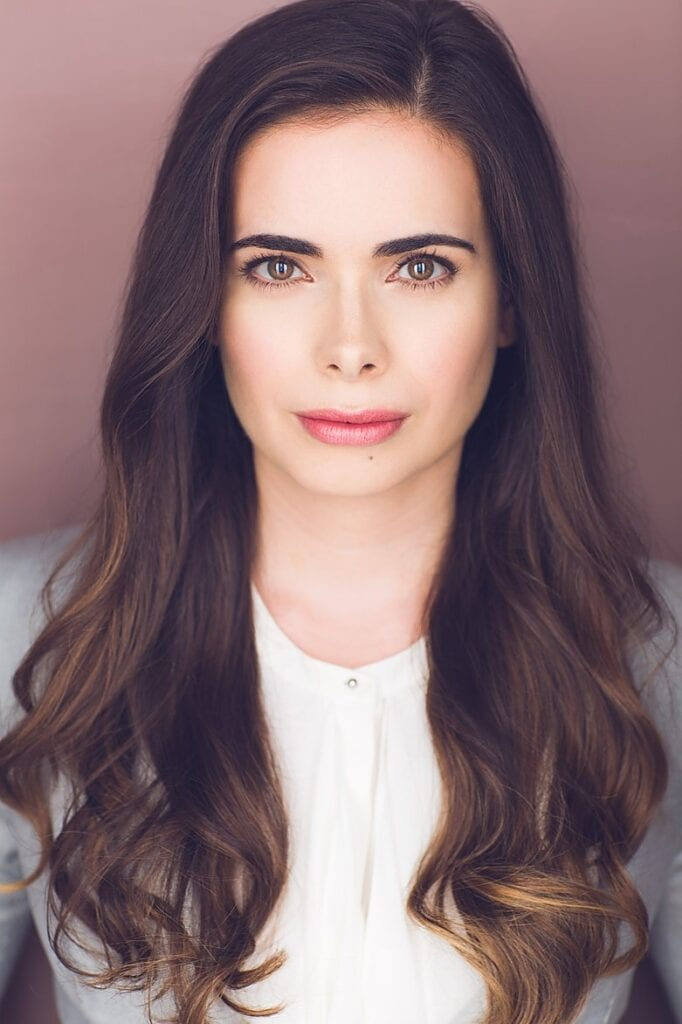 Headshot of Michaela Zannou looking directly at the camera and wearing a white shirt.