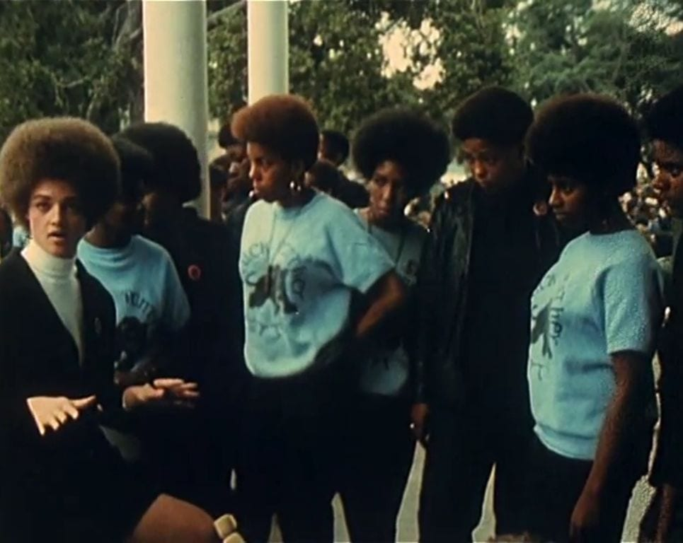 A still from Black Panthers featuring a group of them in blue shirts