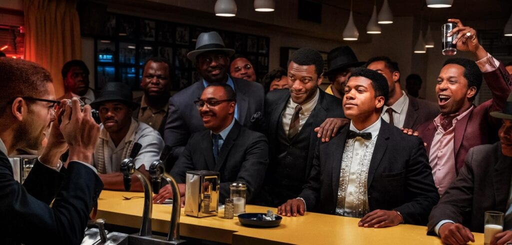 Still from One Night in Miami... with all the characters wearing suits and sitting at a restaurant counter.