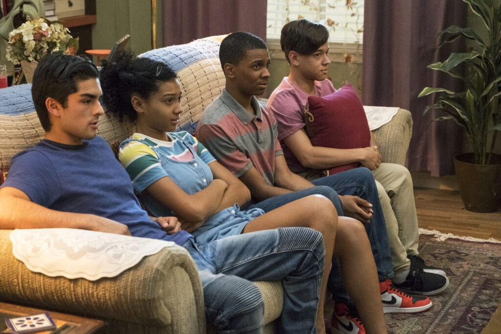 Still from On My Block with four of the main characters sitting on the couch