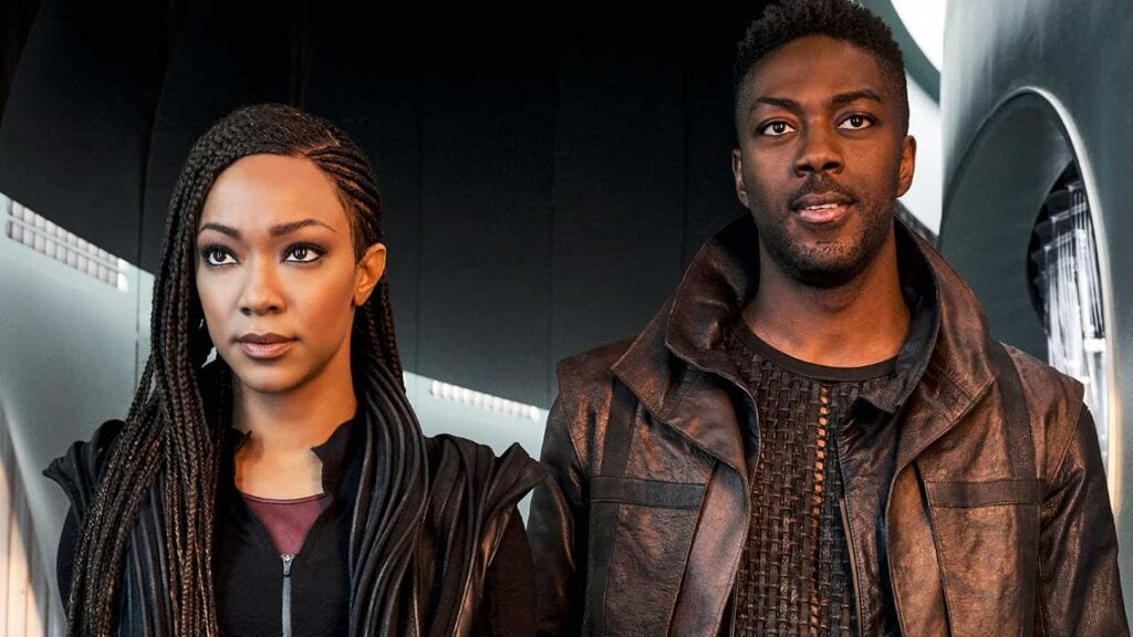 Michael Burnham (Sonequa Martin Green) and Cleveland Booker (David Ajala) stand next to eachother in Star Trek Discovery